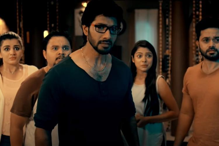 Still from Kannada horror film Mane Number 13 showing actors Varsha Bollamma, Ramana and others