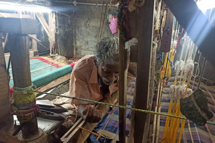A weaver working on a hand loom in Mangalagiri