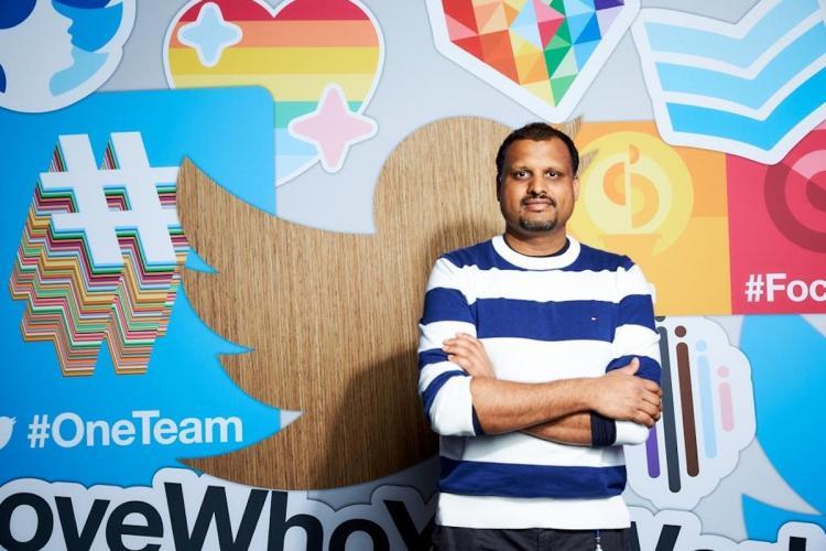 Twitter India Head Manish Maheshwari stands against an illustrated wall