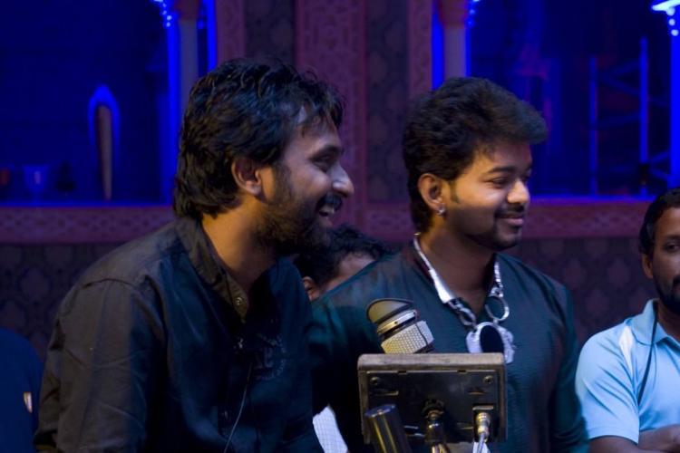 Cinematographer Manoj Paramahamsa and actor Vijay on the sets of Nanban