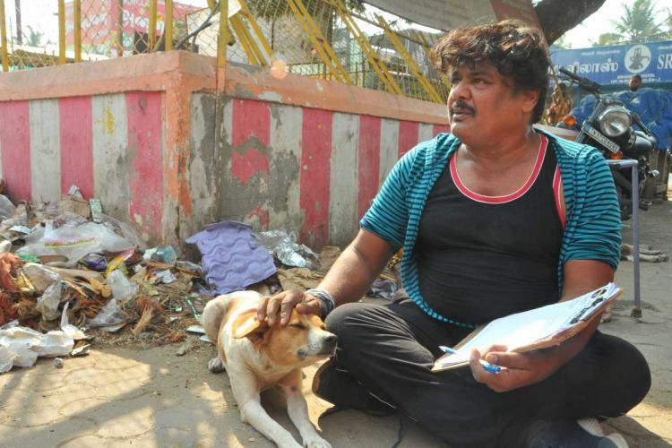 Mansoor Ali Khan sitting near garbage bin to garner votes in Coimbatore and petting dog