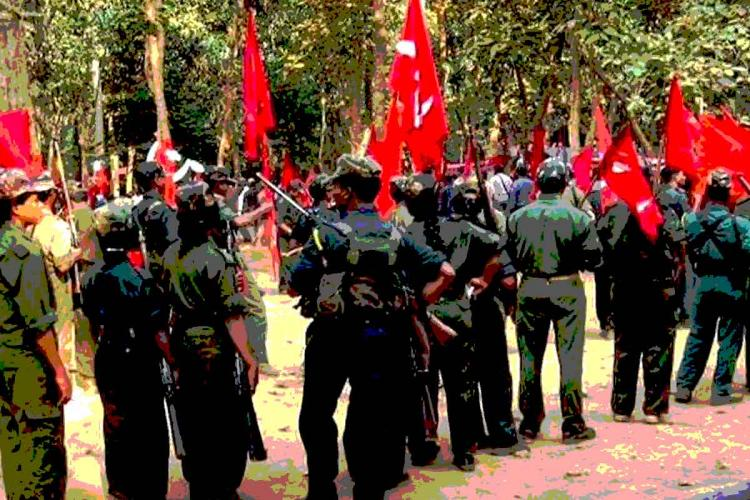 Maoists in representation image with grey dresses and red flags