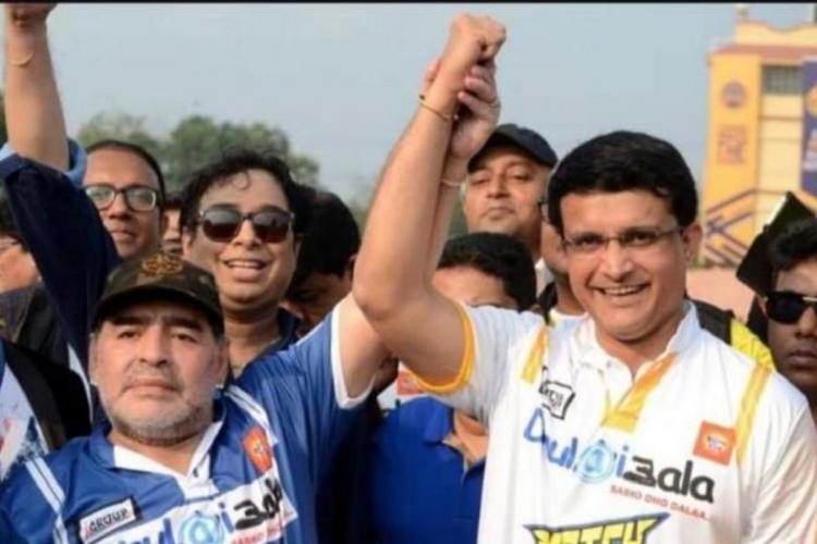 File photo shows Sourav Ganguly with Maradona holding their hands up