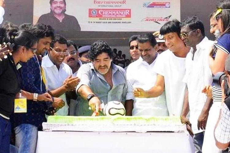 Diego Maradona n front of a cake flanked by IM Vijayan AP Abdullakutty and Thiruvanchoor Radhakrishnan