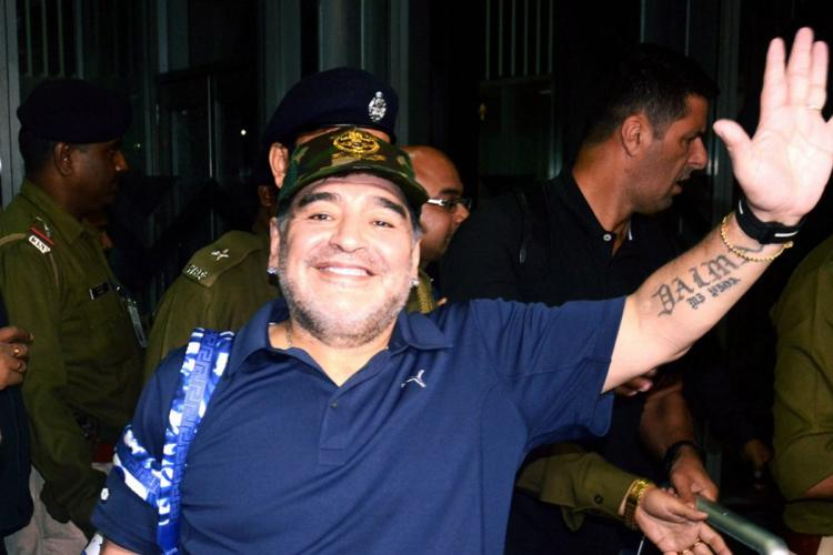 Diego Maradona waving at people He is wearing a blue shirt