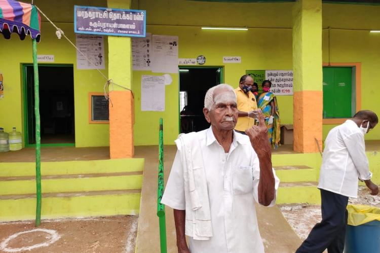 105-year-old Marappa Gounder showing his inked finger after voting in Coimbatore