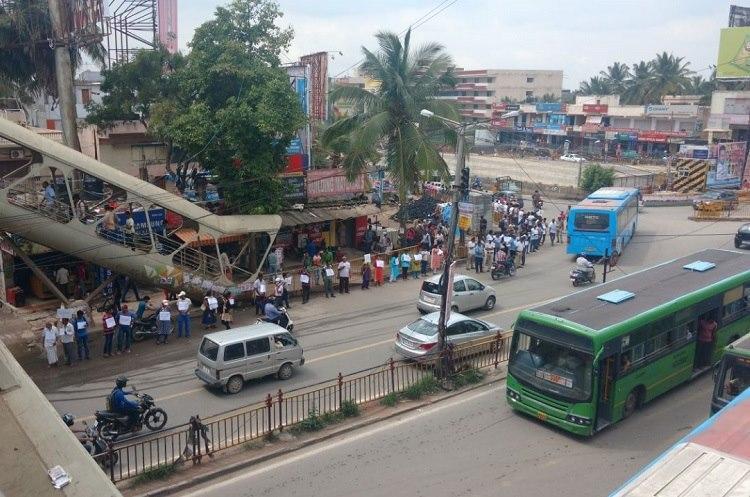 We just want basics Bengaluru residents form 2 km human chain against bad roads