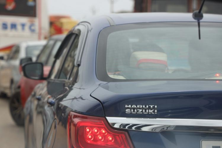 logo of Maruti Suzuki on a Swift on a road in Hyderabad