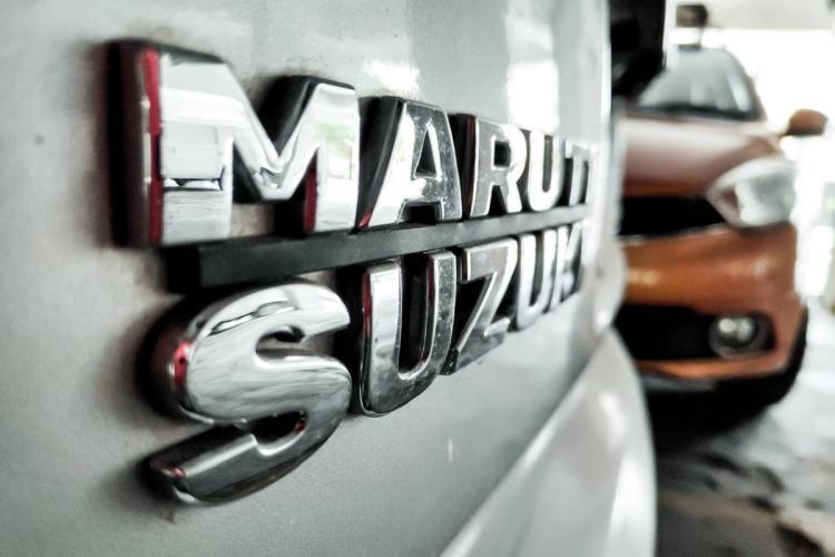 Maruti Suzuki logo on a silver car photo taken in daylight