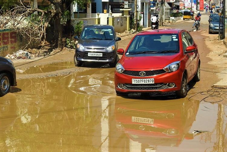 Next to Hyds posh Hitec city overflowing drain and potholed roads greet residents