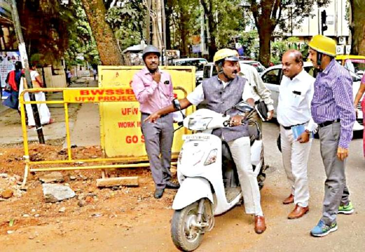 Riding two-wheeler Bengaluru Mayor inspects potholes One more engineer suspended