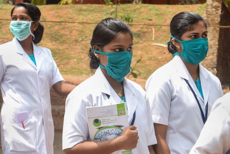 Medical students in uniform wearing face masks