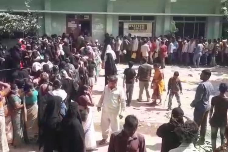 Long queues outside MeeSeva centre in Hyderabad where people are waiting to register for flood relief