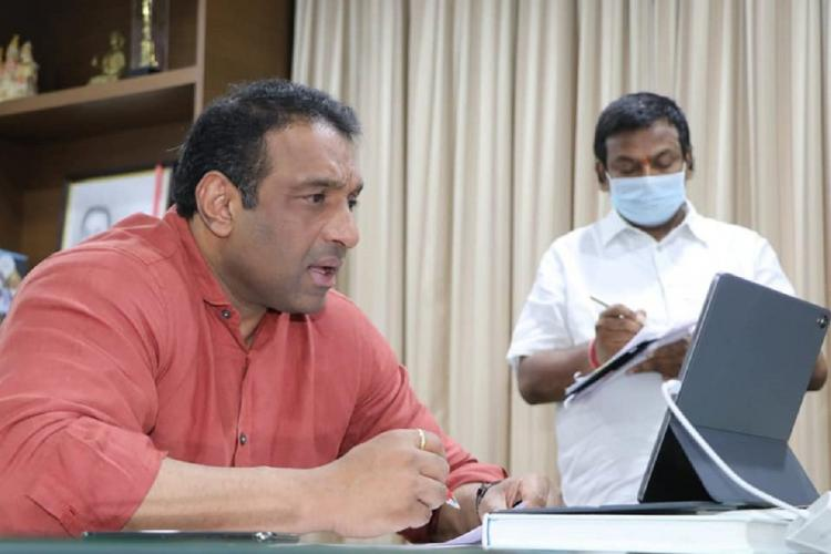Andhra Pradesh IT Minister Mekapati Goutham Reddy in a brick red shirt in an online meeting