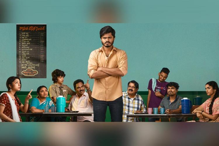 Middle Class melodies poster in which the cast of the movie are seen sitting on benches and the main lead was seen standing in orange shirt