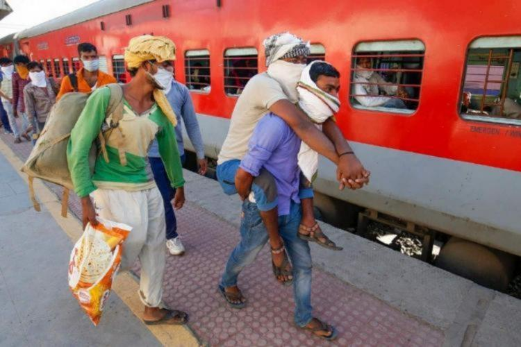 Migrant workers at a railway station platform