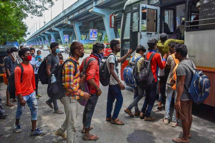 Migrant workers getting into a bus