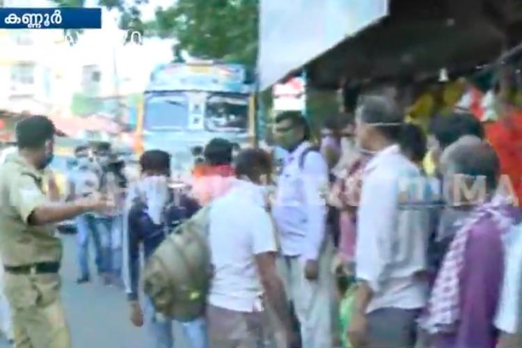 Migrant workers from UP gather at Kannur railway station demand to go home