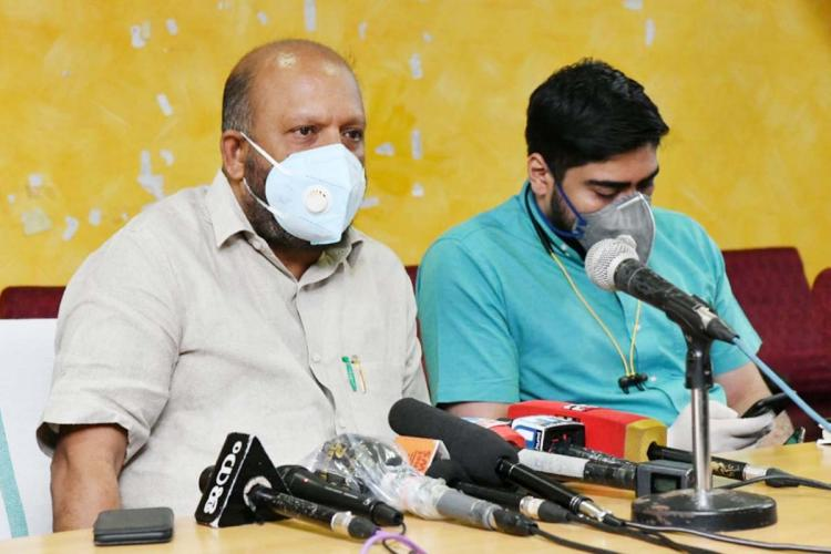 Minister VS Sunil Kumar and Ernakulam Collector S Suhas in a press meet Both are wearing face masks and Minister Sunil Kumar can be seen answering media
