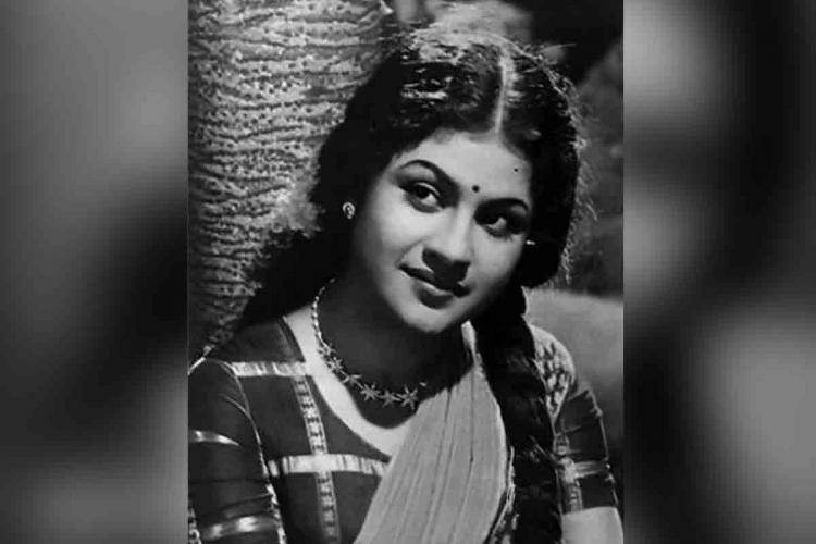 Miss Kumari wearing a dark blouse and a light shawl, with her hair plaited on either side, head bent sideways, looking away in this black and white picture
