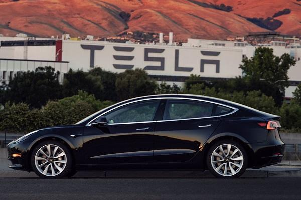 Teslas electric car Model 3 finally a reality as company rolls out first unit