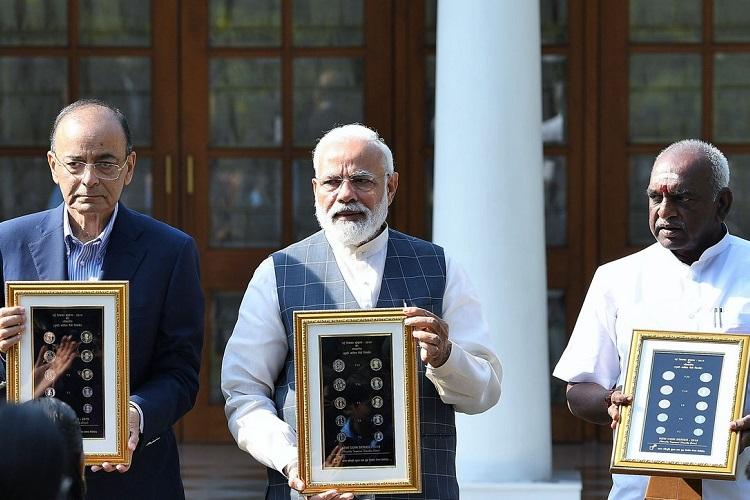 PM Modi releases series of visually-impaired friendly coins including new Rs 20 coin