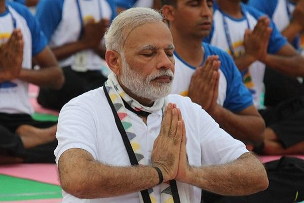 Shiv Sena attacks Modi Asks if yoga can cure inflation