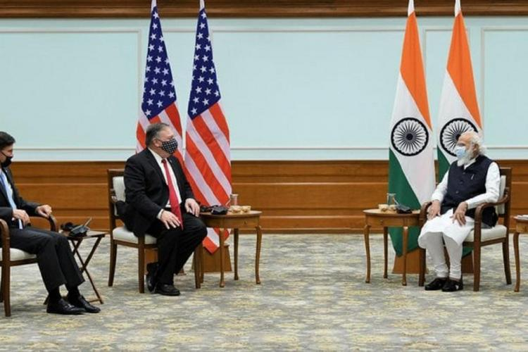 Mike Pompeo and Indian Prime Minister Narendra Modi during a meeting with the flag of their countries behind them