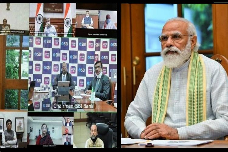 A photo of Prime Minister Narendra Modi participating in a video conference with senior officials
