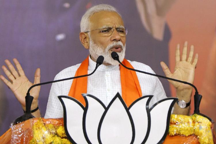 PM narendra modi giving speech on stage