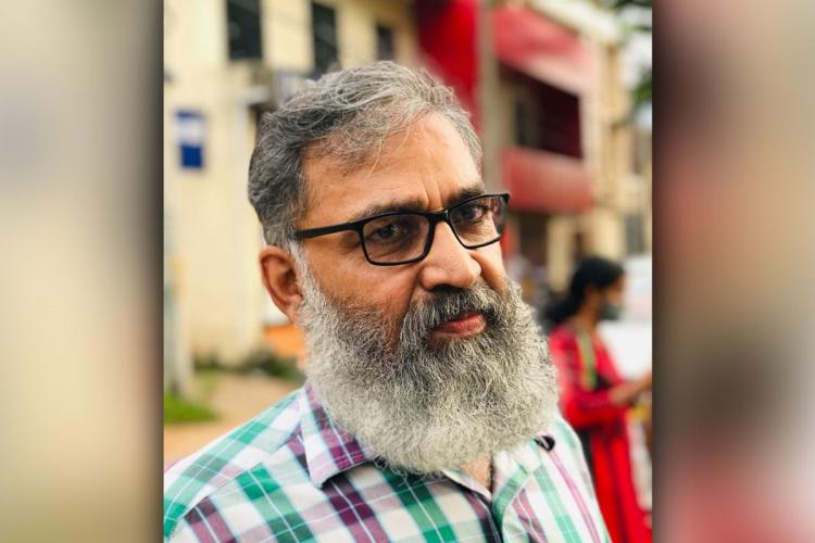 Mohammed Shuhaib Kerala candidate contesting local body polls in a red background
