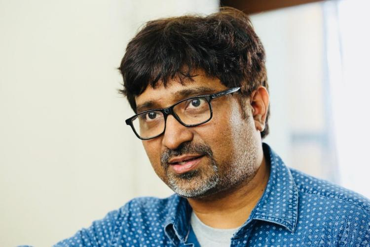 Telugu director Mohana Krishna Indraganti in a blue shirt with glasses