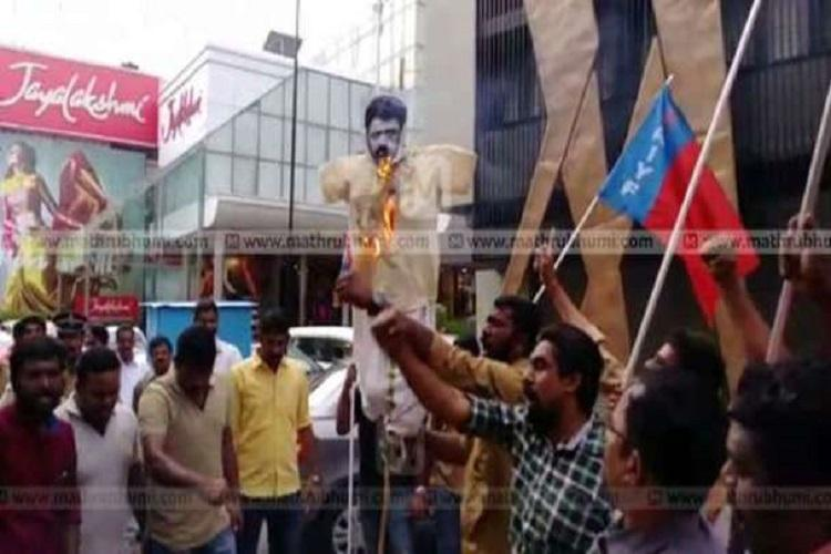 AIYF protests AMMAs decision to reinstate Dileep activists burn Mohanlal effigy
