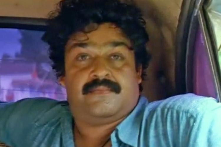 Malayalam actor Mohanlal in a car in Ayal Kadha Ezhuthukayanu