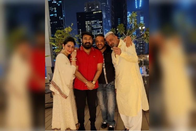 Mohanlal in red t shirt, Sanjay Dutt and wife Maanayata in white on either side, a man in black in between the other two men