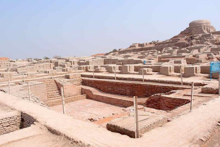 Excavated ruins of Mohenjodaro with the Great Bath in the foreground and the granary mound in the background