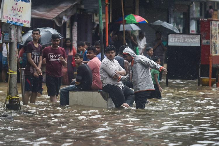 In pics and videos Mumbai paralysed due to heaviest rains in over a decade