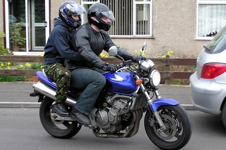 Pillion riders in urban Karnataka dont forget your helmet