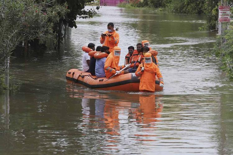 A rescue team helping people reach safer places