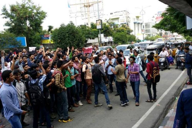Muffakham Jah students in Hyd block busy road demand Foot-over-Bridge