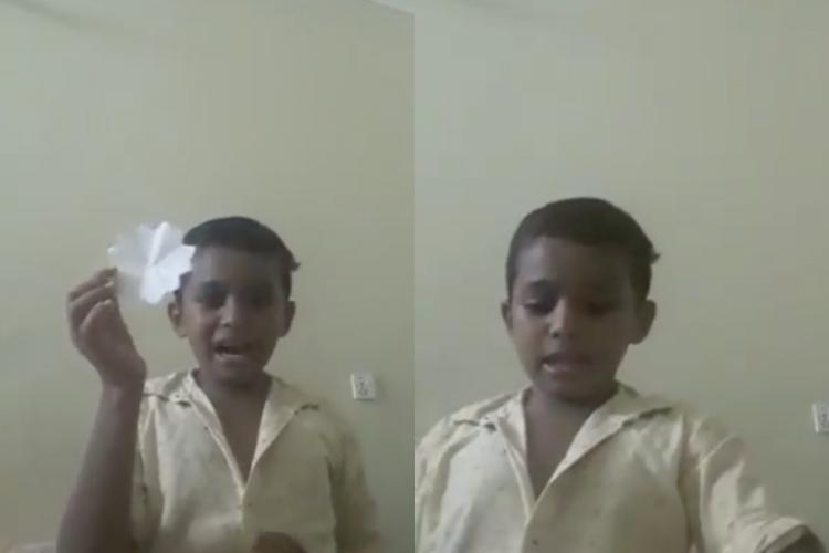A young boy teaching how to make a paper flower