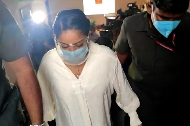 Mumaith Khan dressed in a white shirt appeared at the Enfocement Directorate office