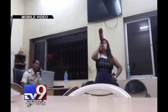Video Mumbai woman downs beer inside police station misbehaves with cops