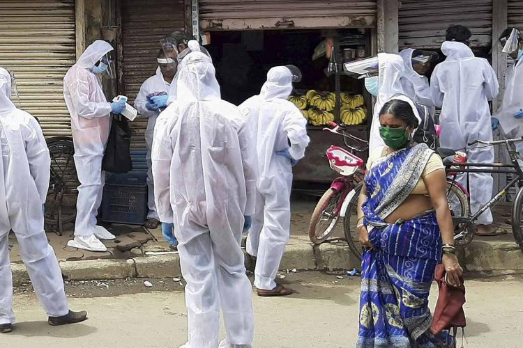 a group of Healthcare workers in PPE in a neighbourhood in mumbai