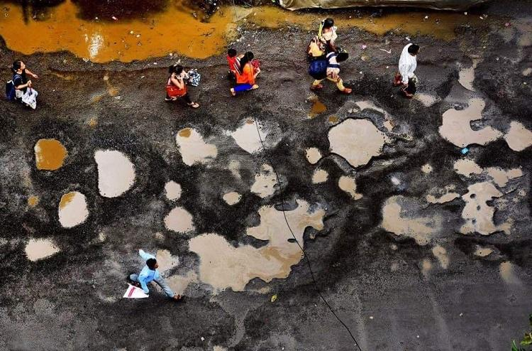 The viral image of people walking on the moon Its actually from Mumbai