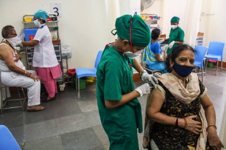 People getting vaccinated at a health centre in Mumbai