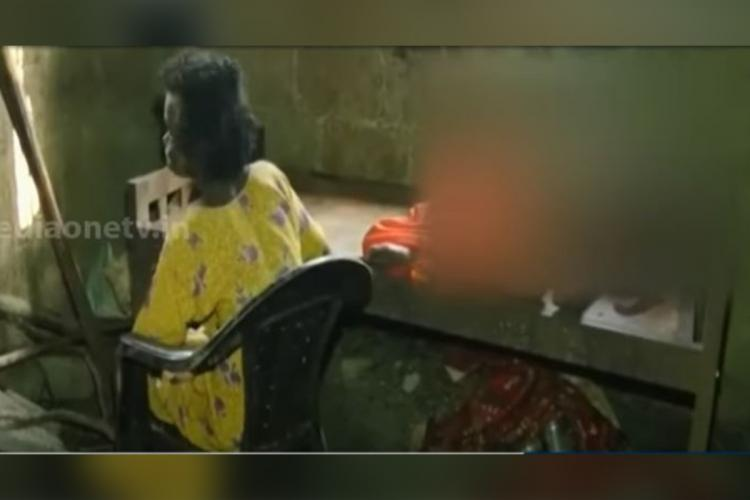 Kerala couple locked inside room Woman is sitting beside a bed where her husband is sleeping