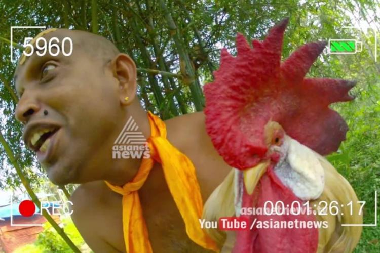 Still of motta with rooster in Munshi Malayalam satirical show