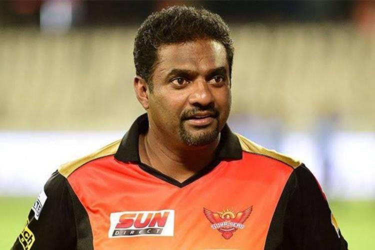 Muttiah Muralitharan dressed in Sunrisers Hyderabad jersey in a stadium