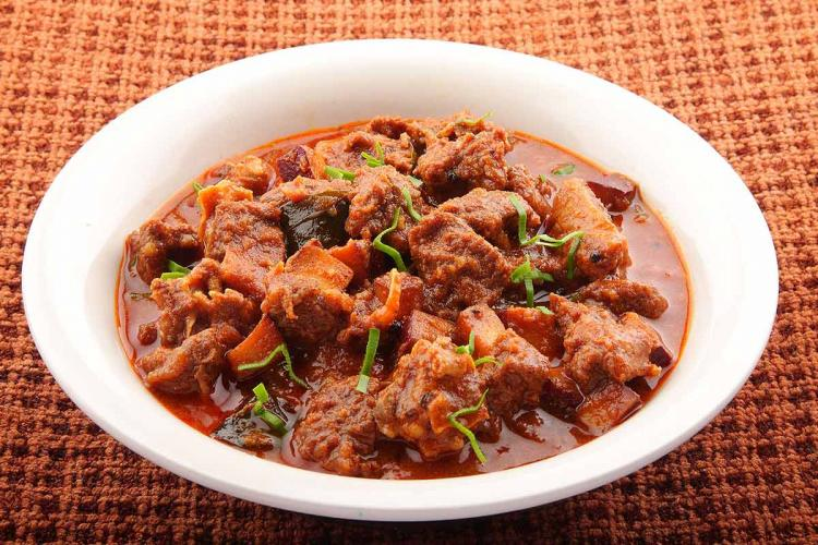 Mutton curry in a big white bowl